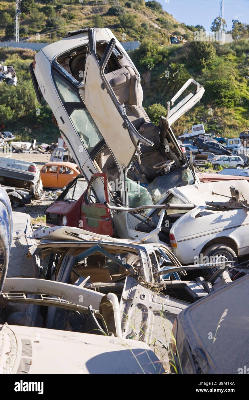 Old motor cars in municipal rubbish dump centre for waste treatment Marbella Malaga Province Costa del Sol Spain - Stock Image