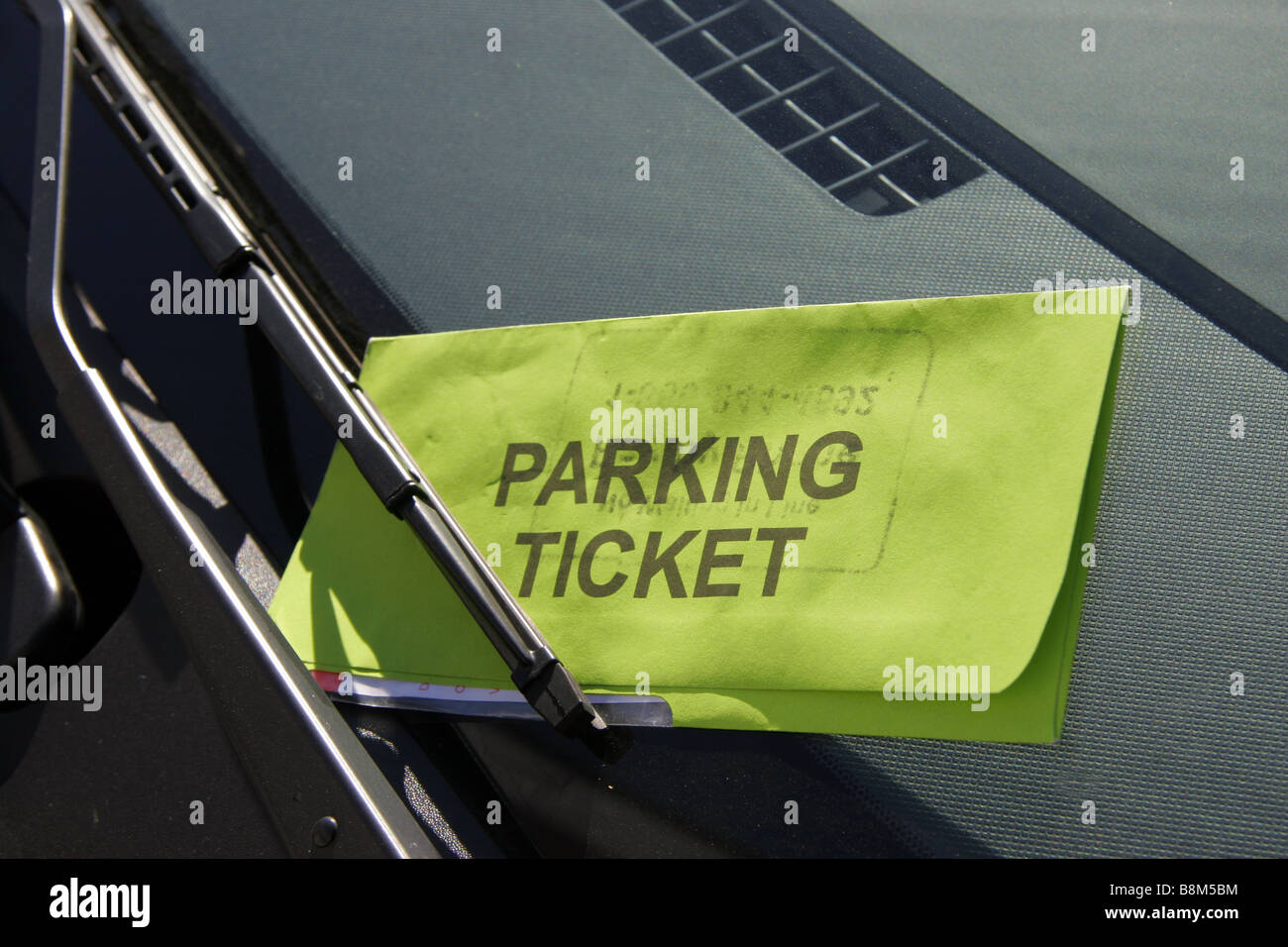 Parking ticket left on car windscreen - Stock Image