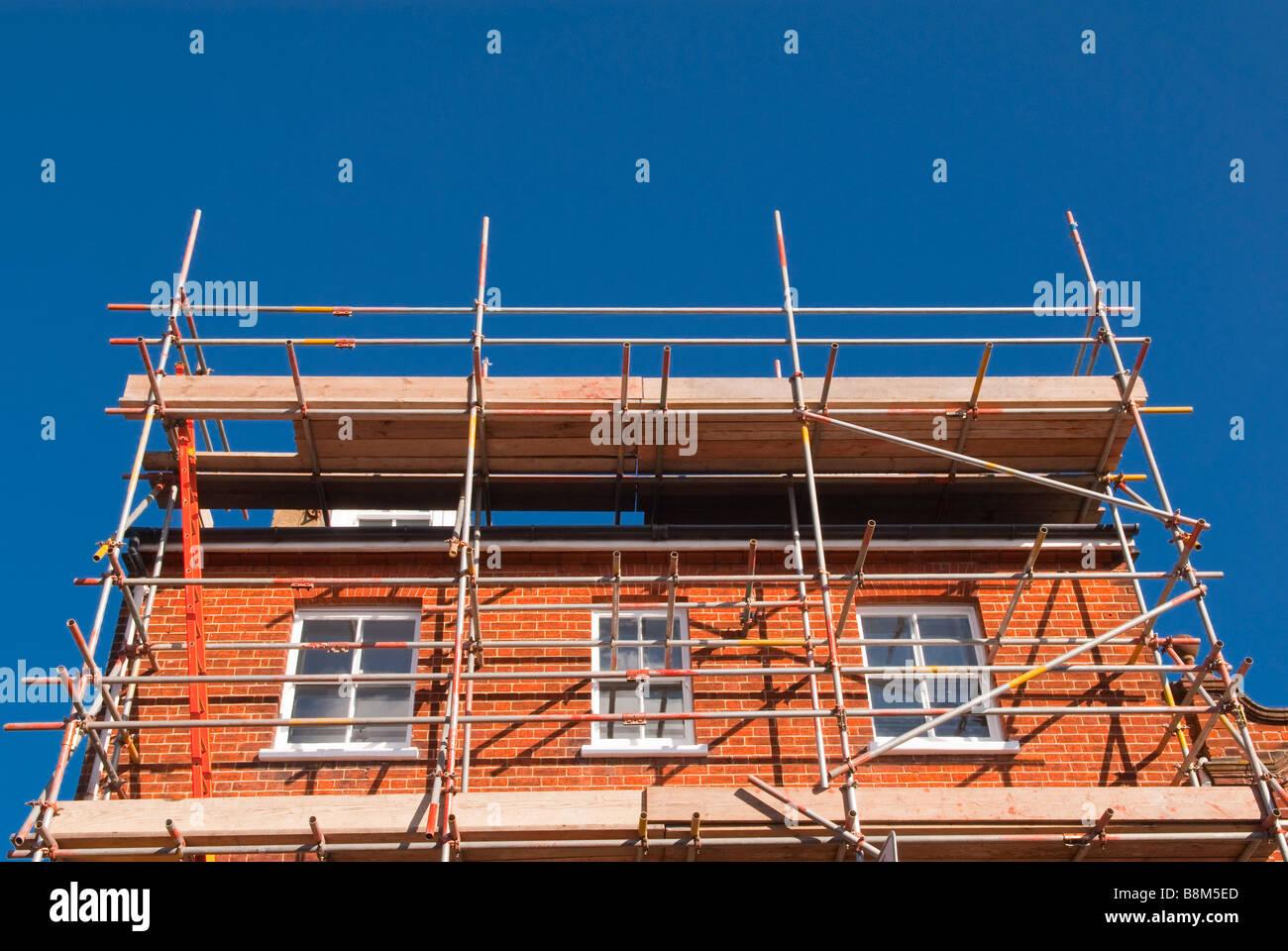 Scaffolding Set Up : Red brick house stock photos