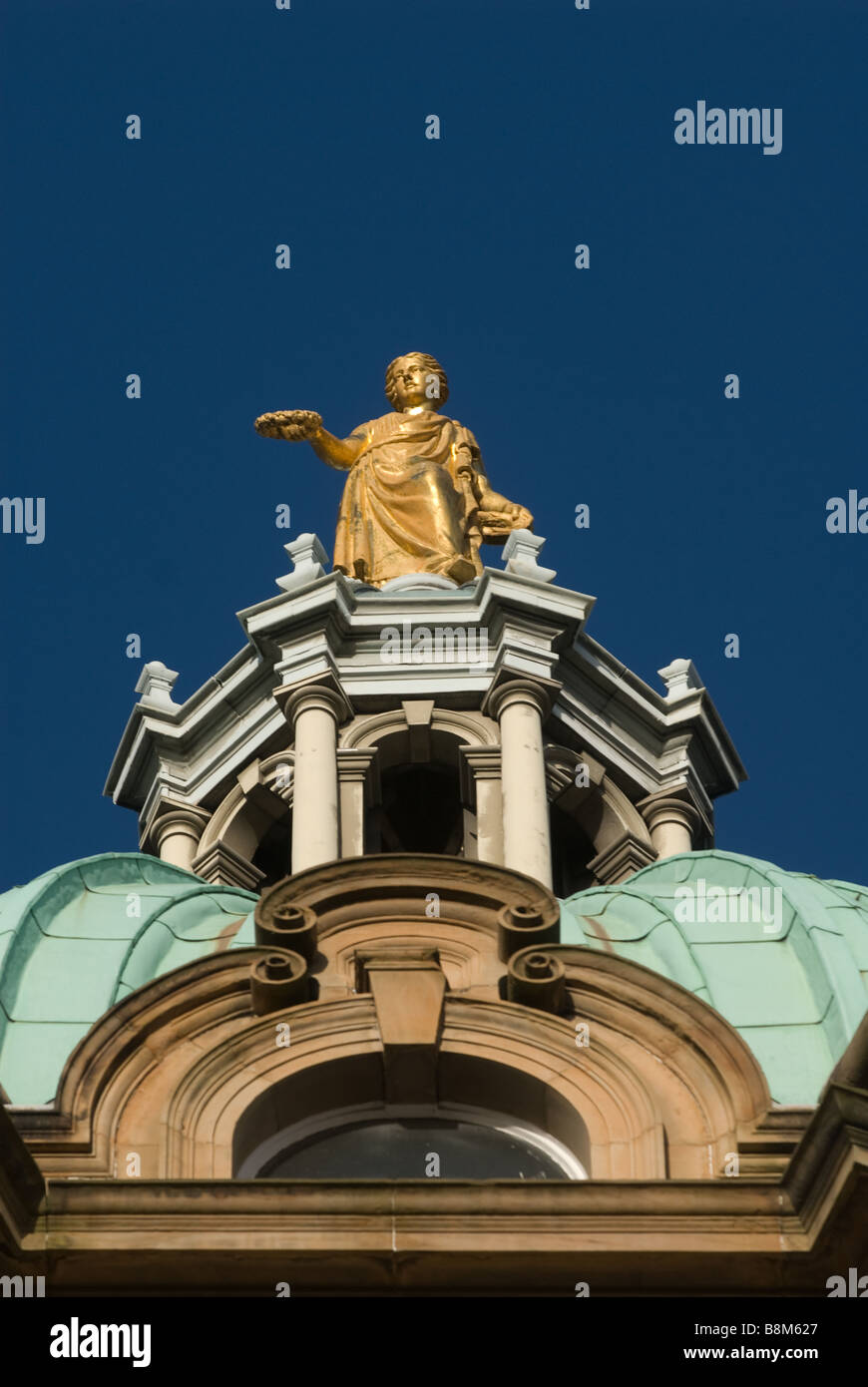 photograph of hbos bos hq golden girl statue on domed tower - Stock Image