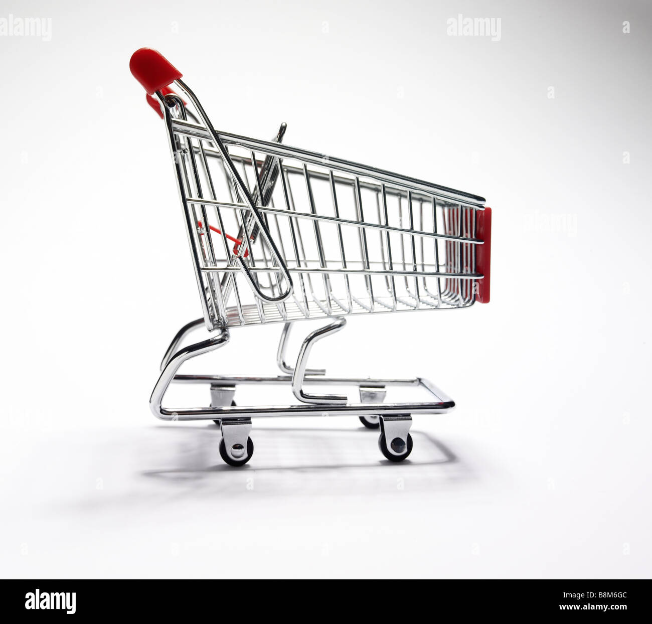 miniature shopping trolley - Stock Image