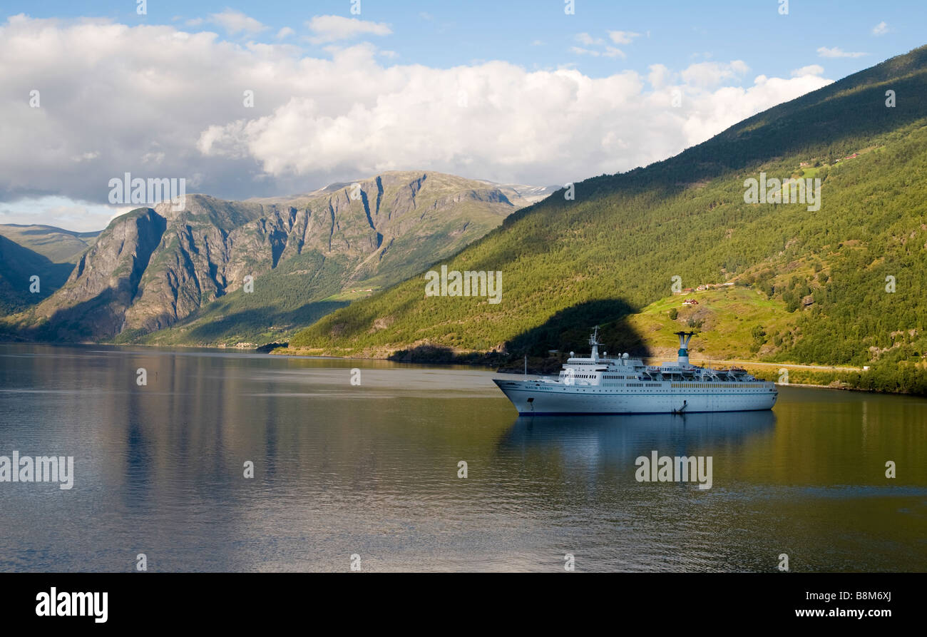 Cruise ship SS Maxim Gorky (1968), of Phoenix Reisen, at anchor in Aurlandsfjord at Flaam, Norway.  Ship sold for - Stock Image