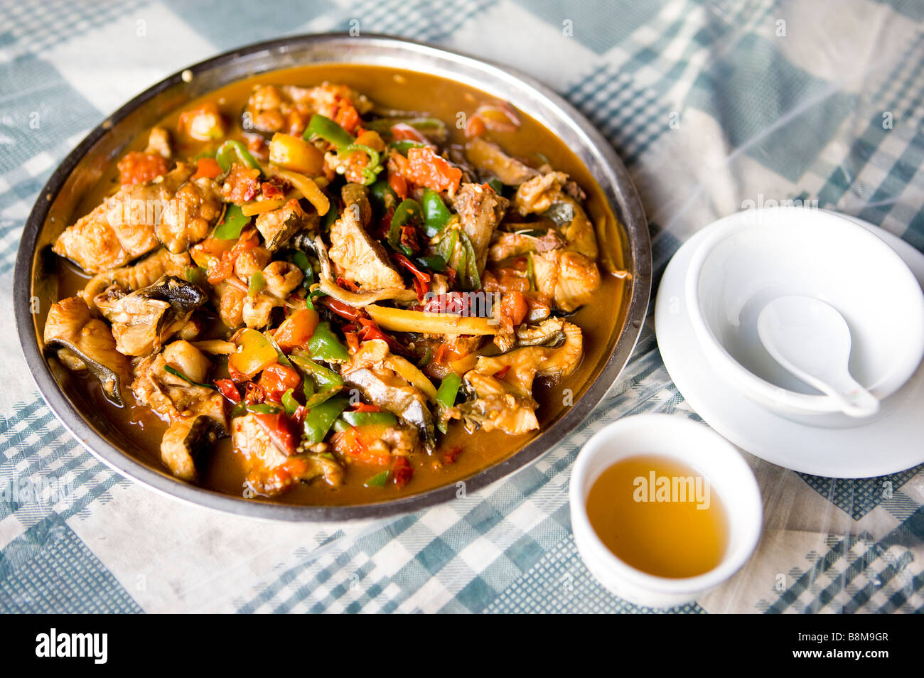 China Guangxi Province Guilin Yangshuo beer fish and stewed pork on the table Stock Photo