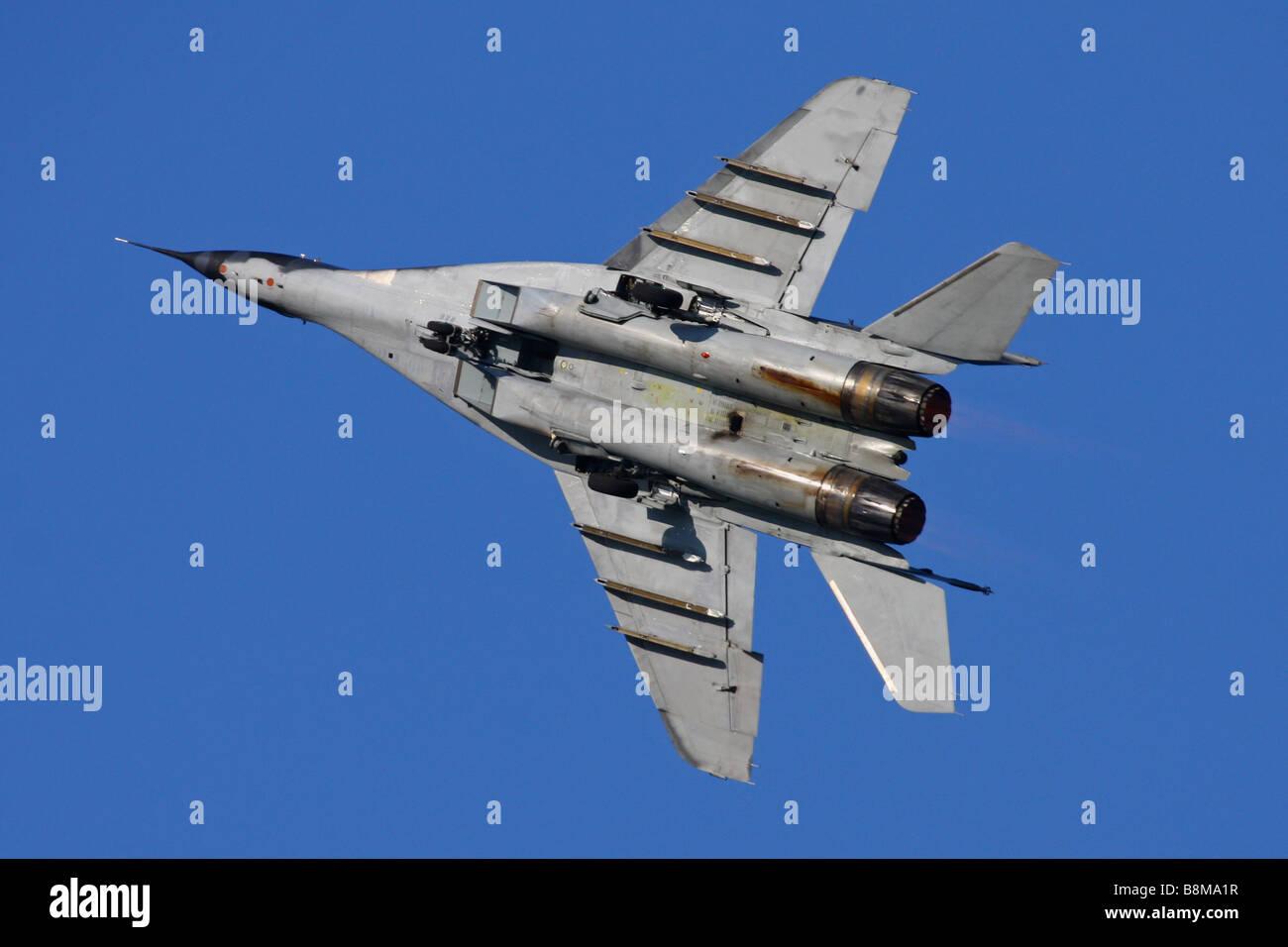 Flying military combat jet. - Stock Image