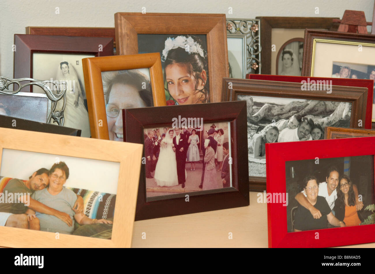 A group of photographs in someones home - Stock Image