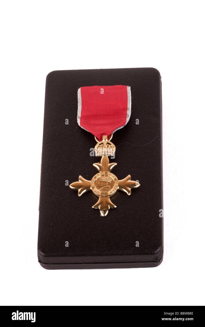 Order of the British Empire OBE Honours award emblem medal and ribbon and presentation box UK - Stock Image