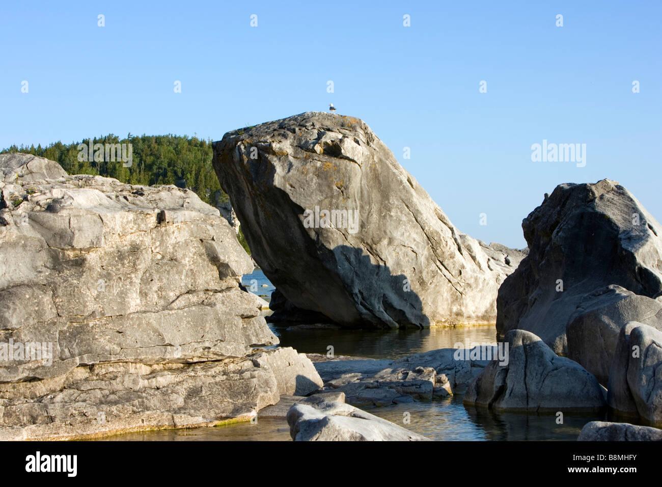 North America Canada Ontario Georgian Bay Bruce Peninsula National Park Halfway Log Dump boulders in water - Stock Image