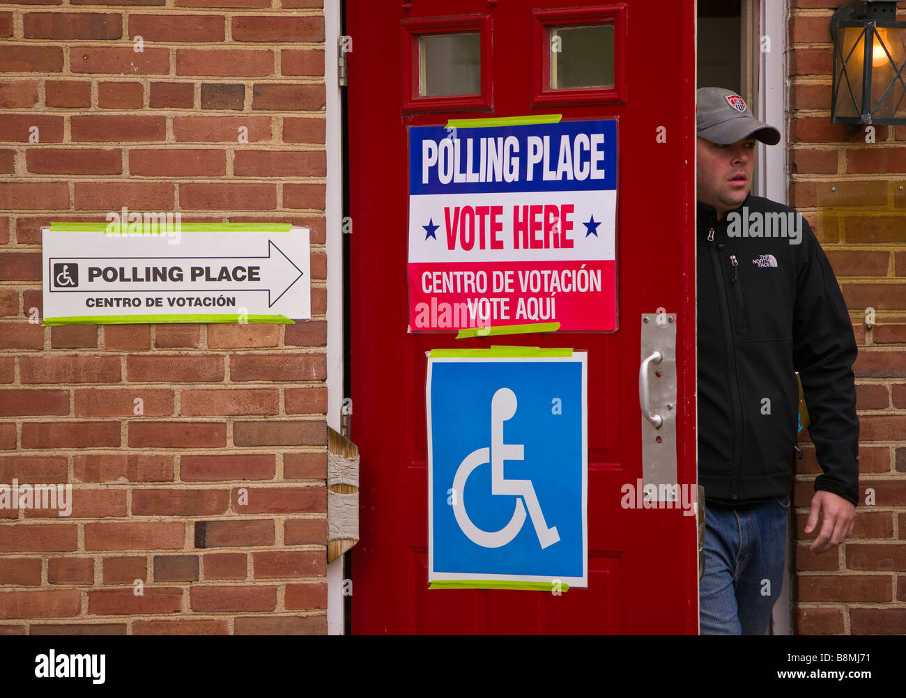 ARLINGTON VIRGINIA USA Voter exiting polling place after voting on presidential election day November 4 2008 - Stock Image