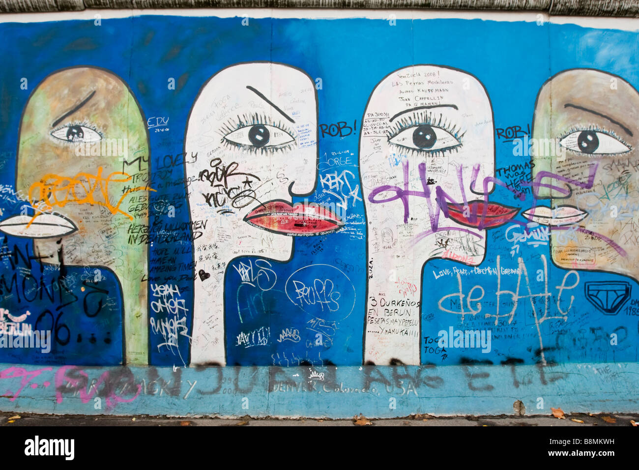 Graffi at the East side gallery of the Berlin wall - Stock Image