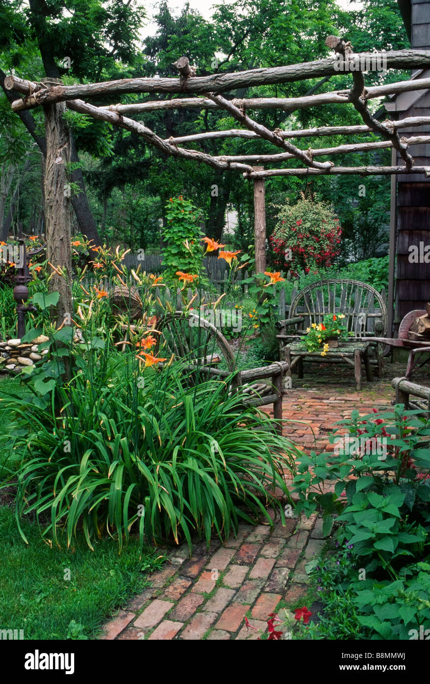 This Colonial Style Garden Features A Rustic Locust Log Arbor With Grapevine  Furniture And Historically Correct Plants.