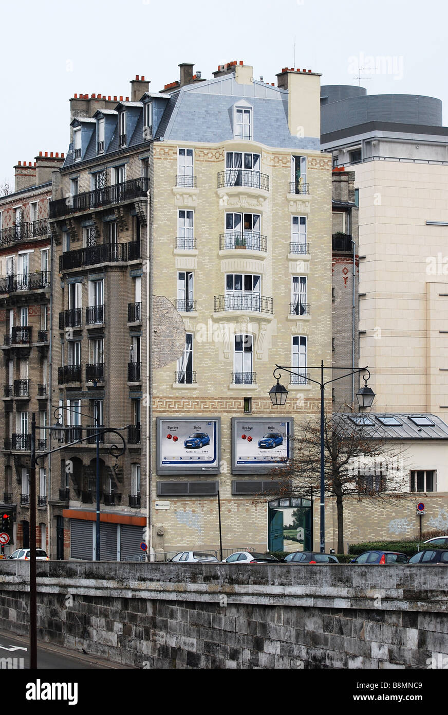 Ugly gable wall painted over paris number 2704 - Stock Image