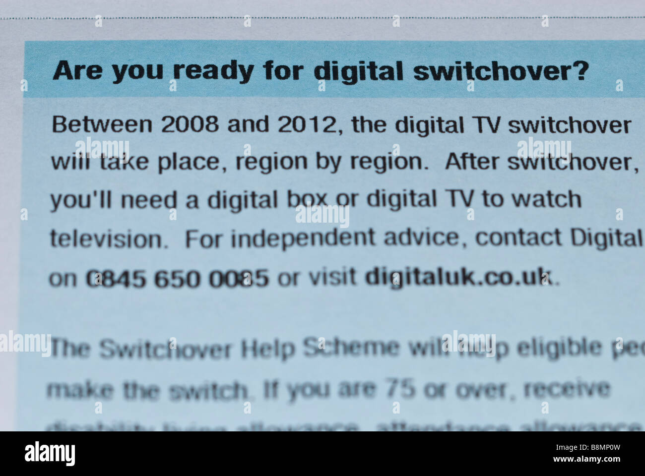 A close up of a uk tv television licence stating...Are you ready for digital switchover when you'll need a box - Stock Image