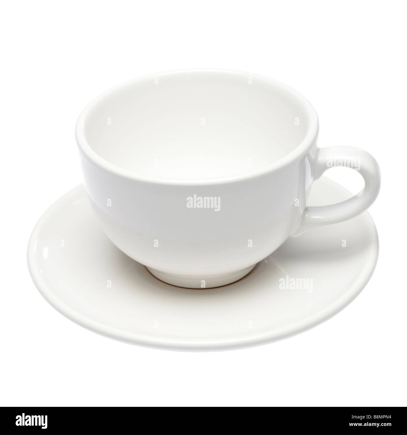 Empty white cup and saucer on white cutout - Stock Image