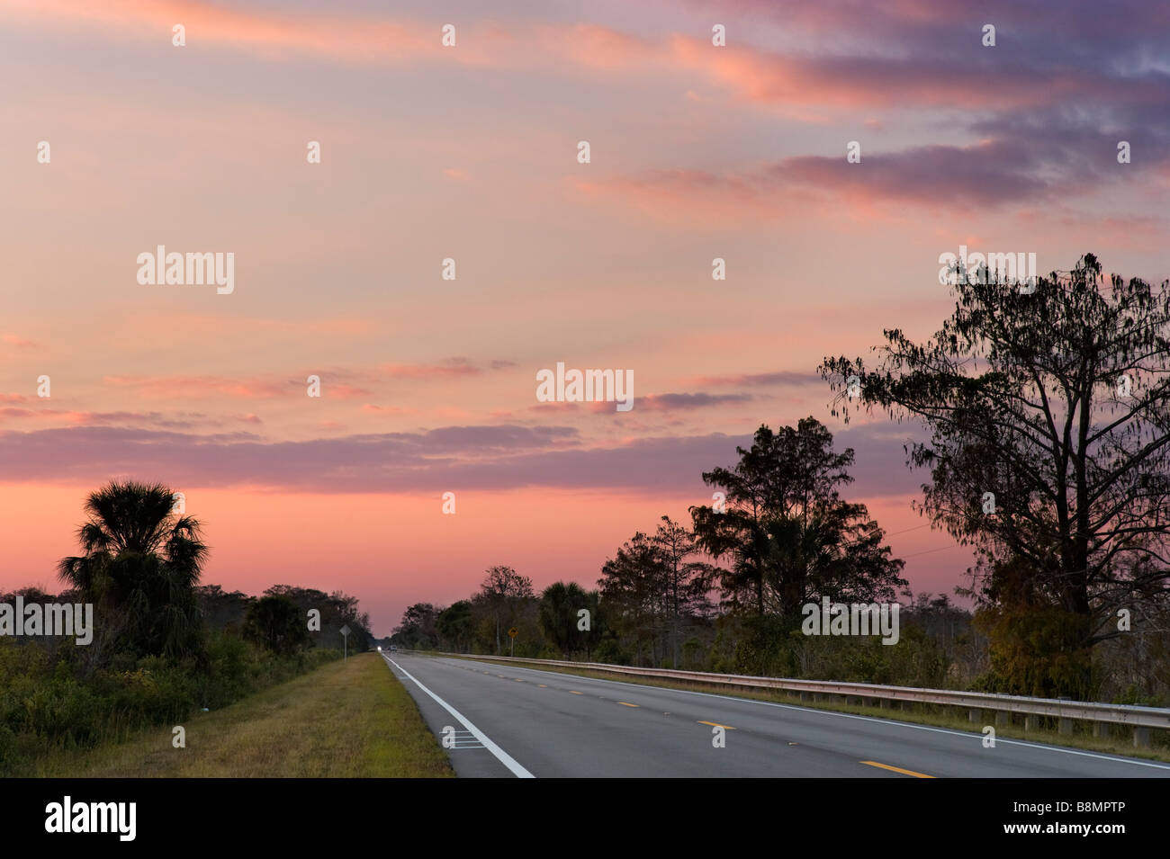 The Tamiami Trail (US 41) at sunset in the Big Cypress National Preserve, Florida Everglades, Florida, USA - Stock Image