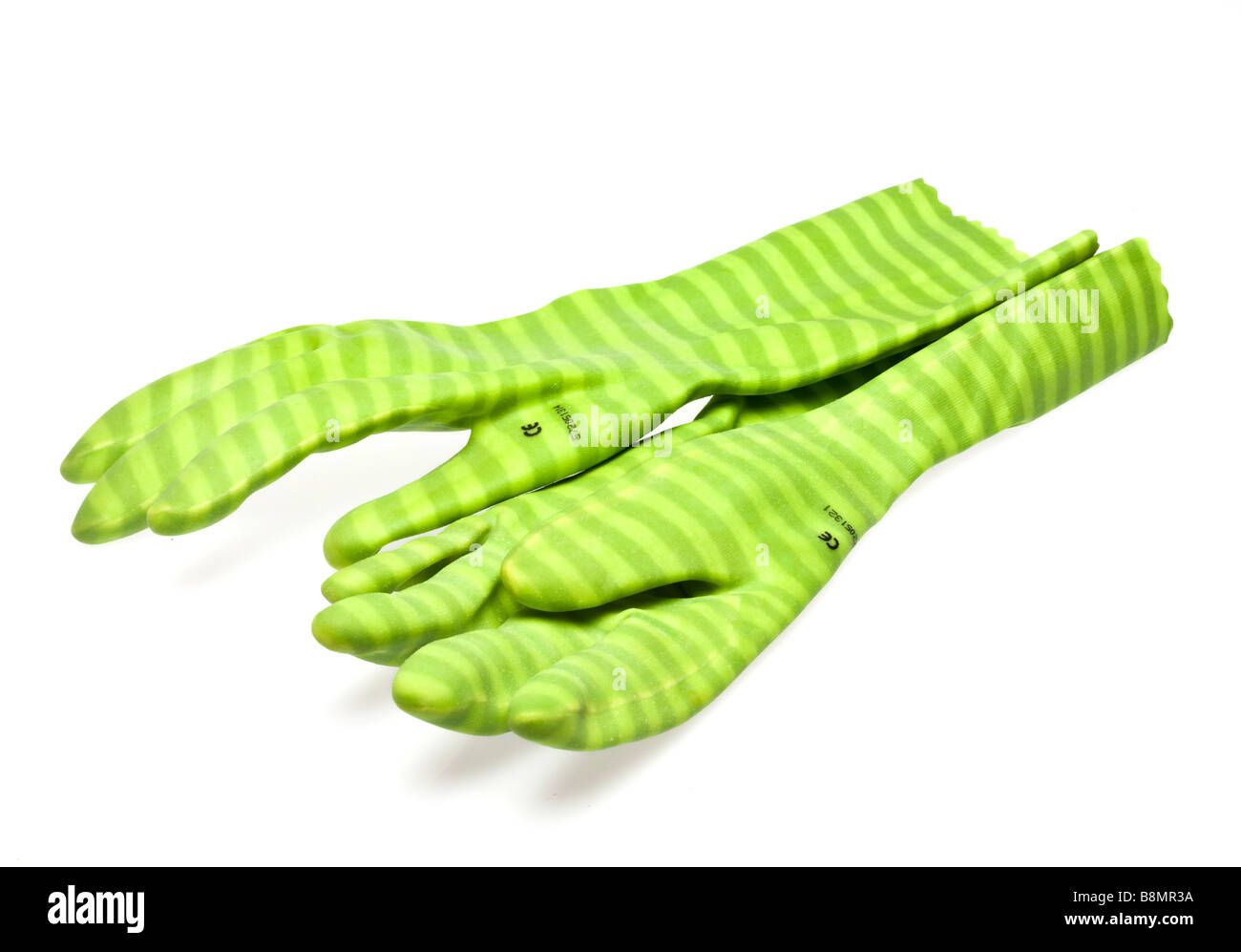Pair of green stripey rubber gloves on white cutout - Stock Image