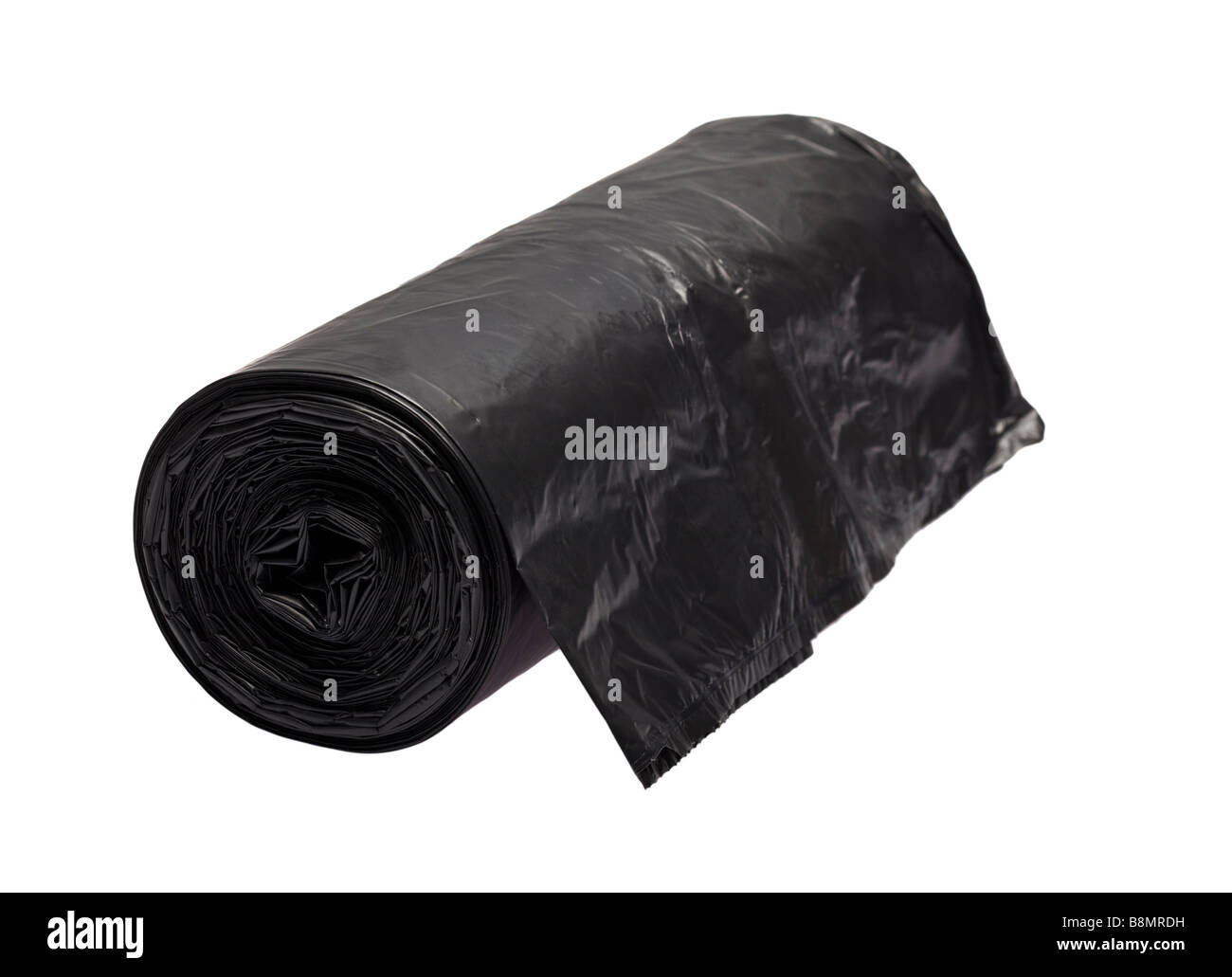 Roll of black bin liners on white cutout - Stock Image