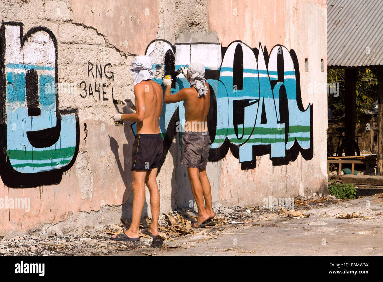 India Andaman and Nicobar Havelock island number 3 village bazaar Russian traveller painting grafitti on wall - Stock Image