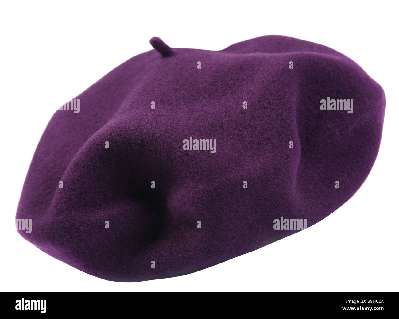 947009ee093 Accessory purple beret closeup on white background - Stock Image