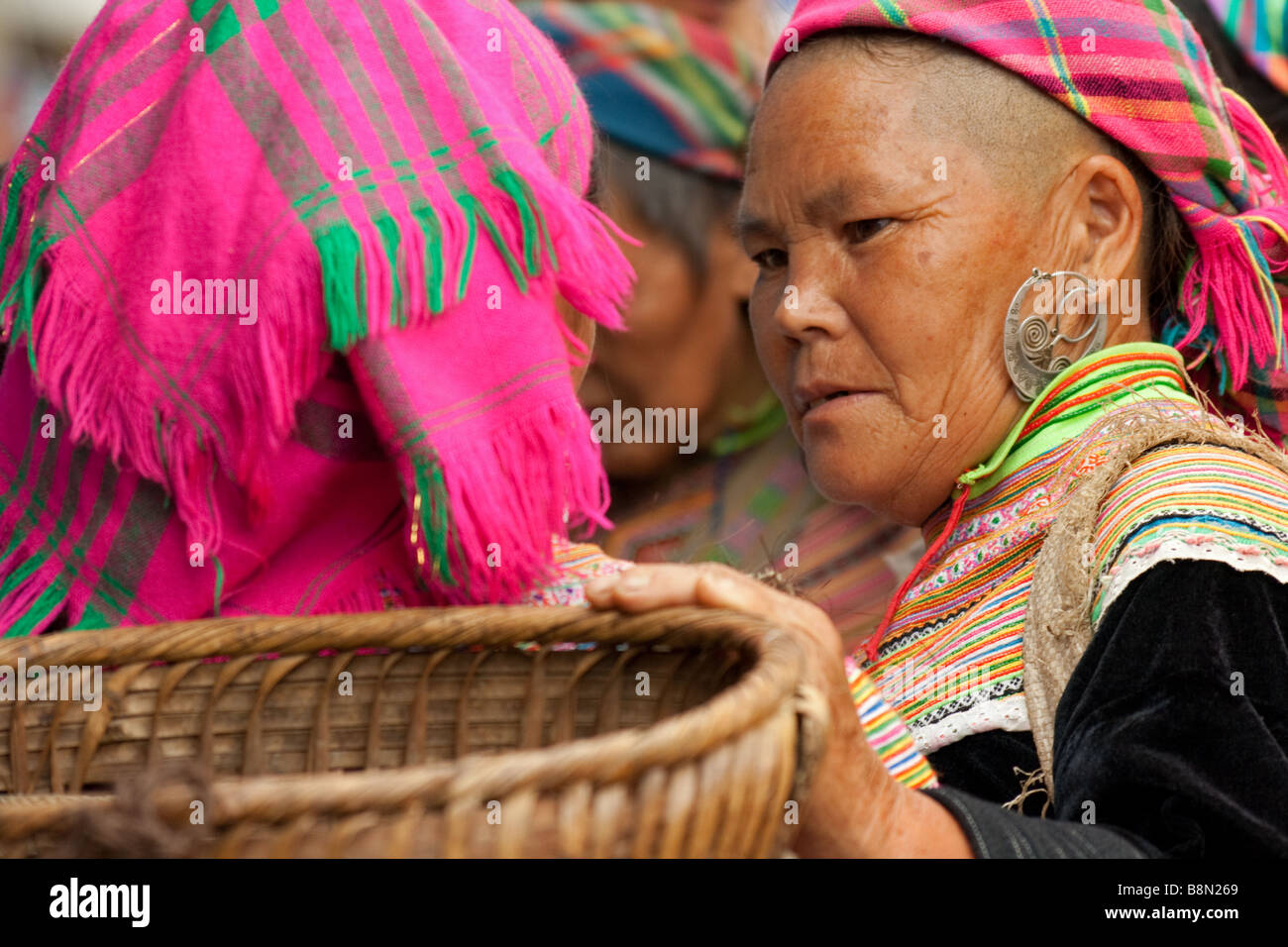 Colorful Flower H'mong tribal women on market day in Bac Ha, Vietnam. The tribal market and socializing ethnic minorities Stock Photo