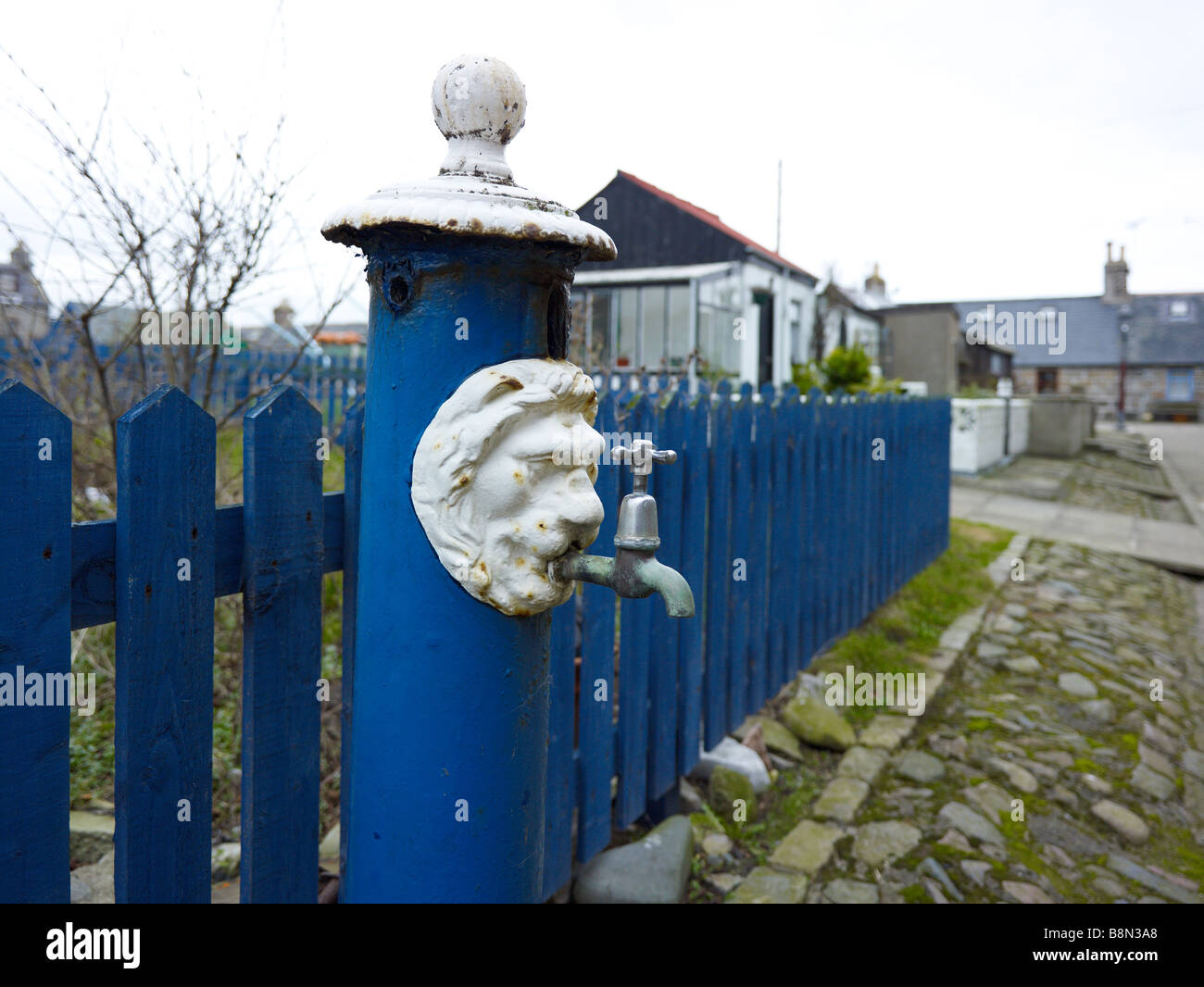 Ornate water tap with a lion's head at the village of Foodee, Aberdeen, Scotland - Stock Image