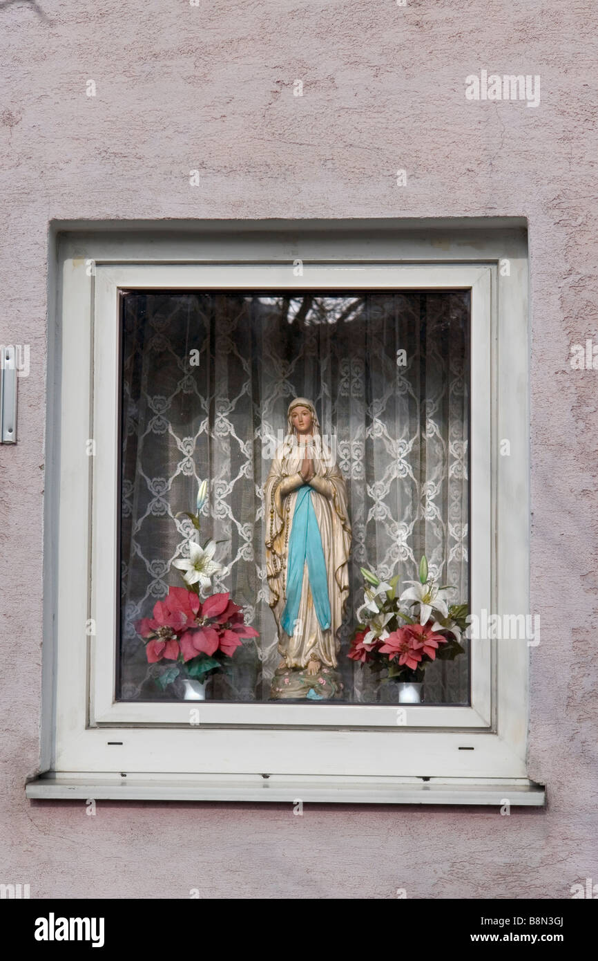 statue of Our Lady in a private house window - Linz - Austria - Stock Image