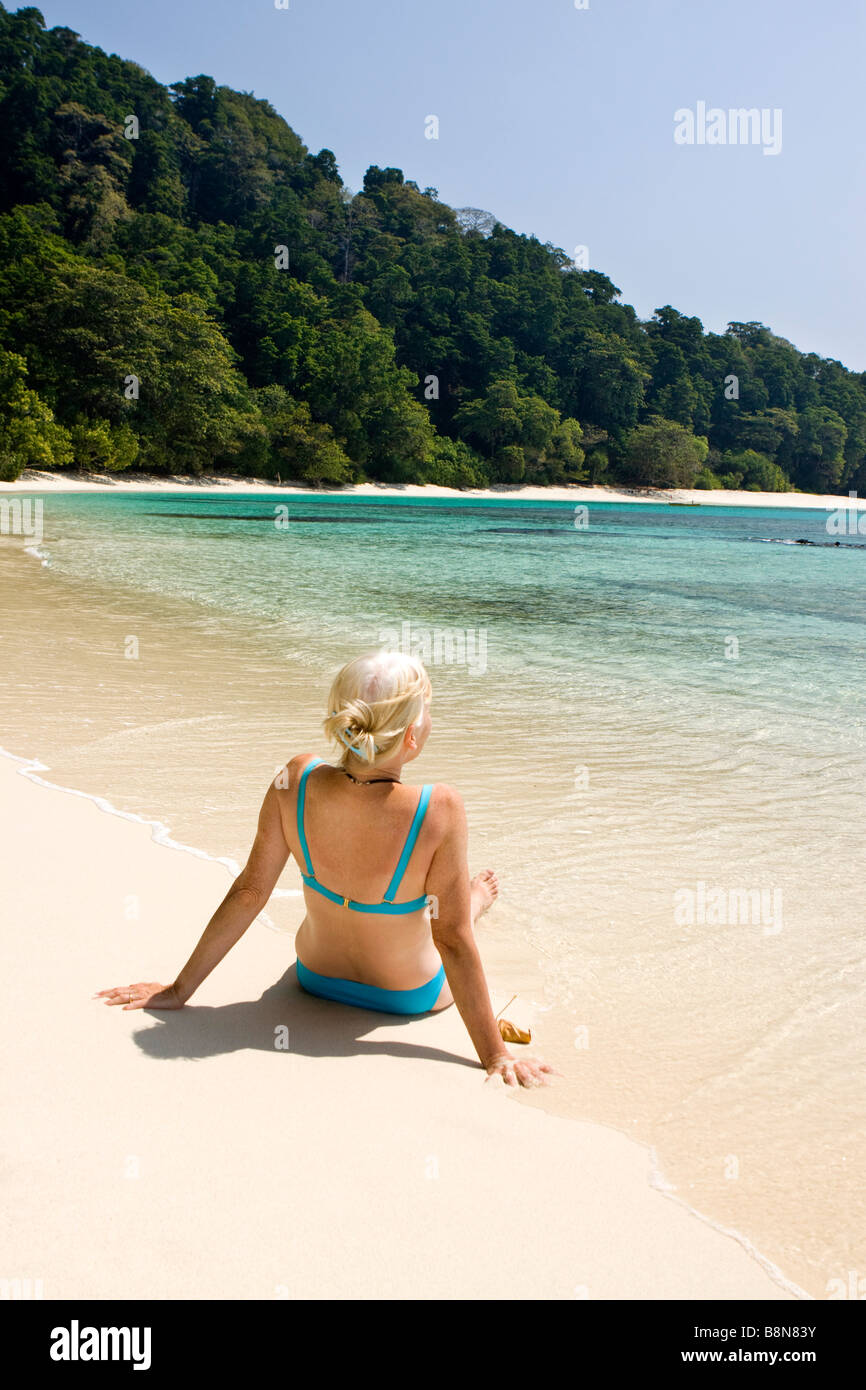 India Andaman and Nicobar Havelock island Radha Nagar middle aged woman in bikini on number 7 lagoon beach - Stock Image