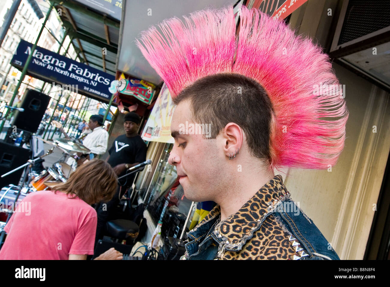 Young punk with pink Mohawk hairstyle - Stock Image