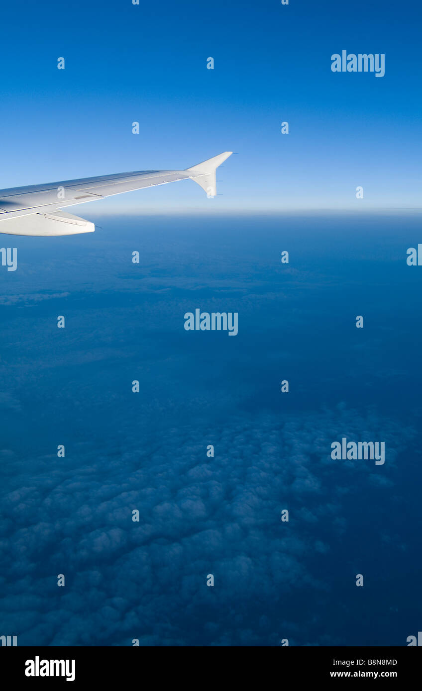 Airplane Wing With Blue Sky, Clouds & Horizon - Stock Image