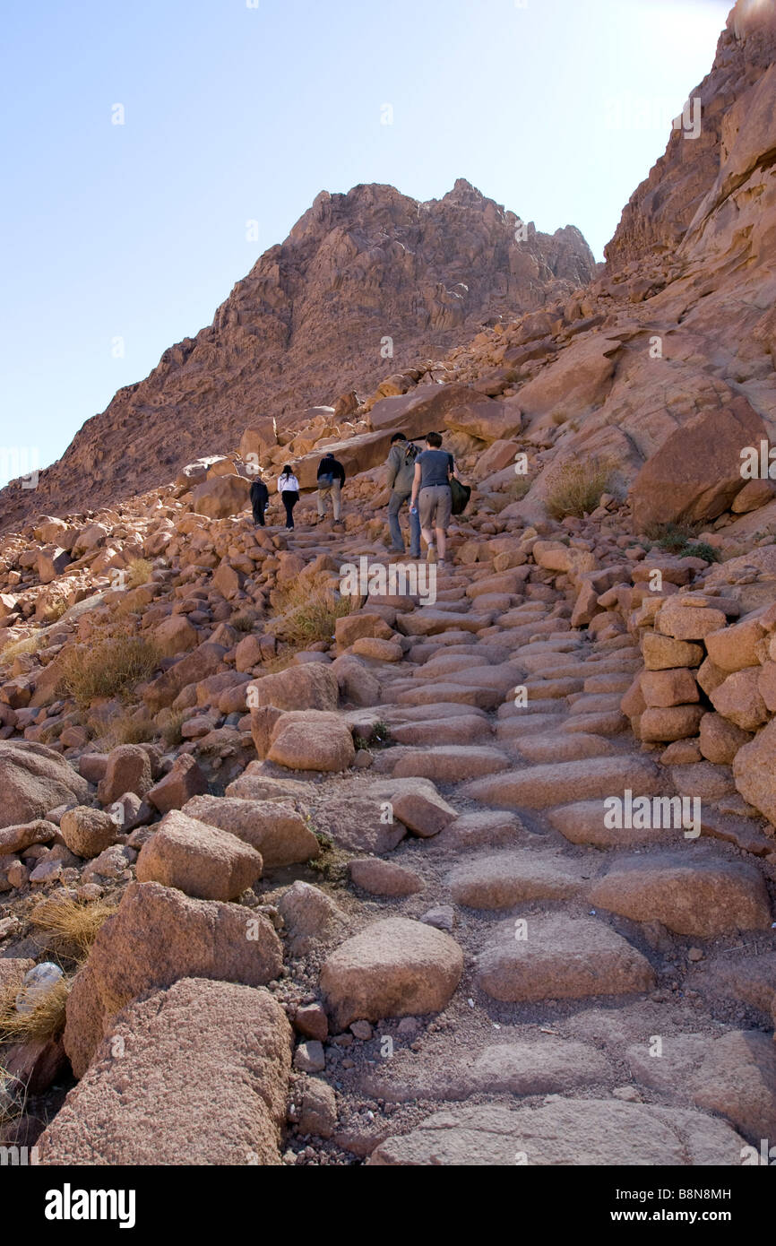 guides and trekkers climbing up the stair way of mount Sinai, the mount of God, Sinai, Egypt - Stock Image