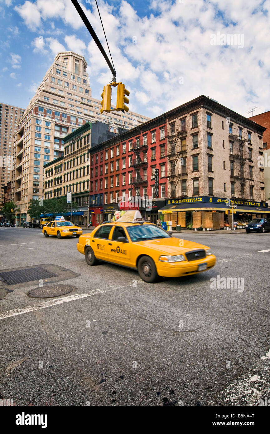 Street scene of  93th street with yellow taxi cabs - Stock Image