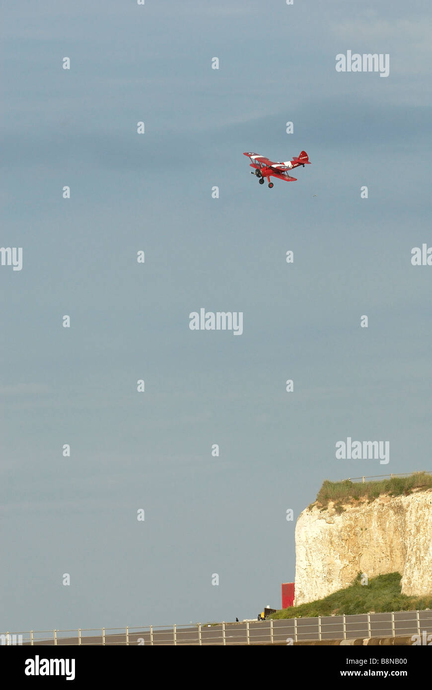 Bi plane over white cliffs Stock Photo