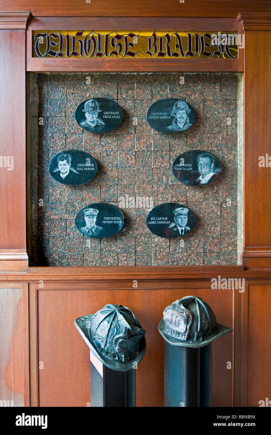 Memorial for fire fighters who lost their lives during the 9/11 disaster at New York city fire station - Stock Image
