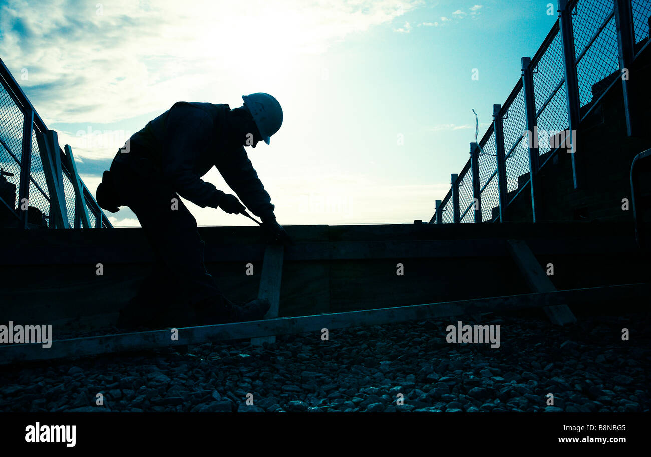Silhouette of a Workman - Stock Image