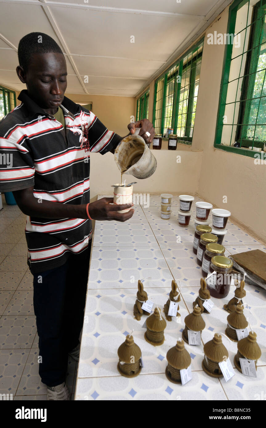 """Man pouring 'bee wax' beeswax into a candle mould, The Gambia """"West Africa"""" - Stock Image"""