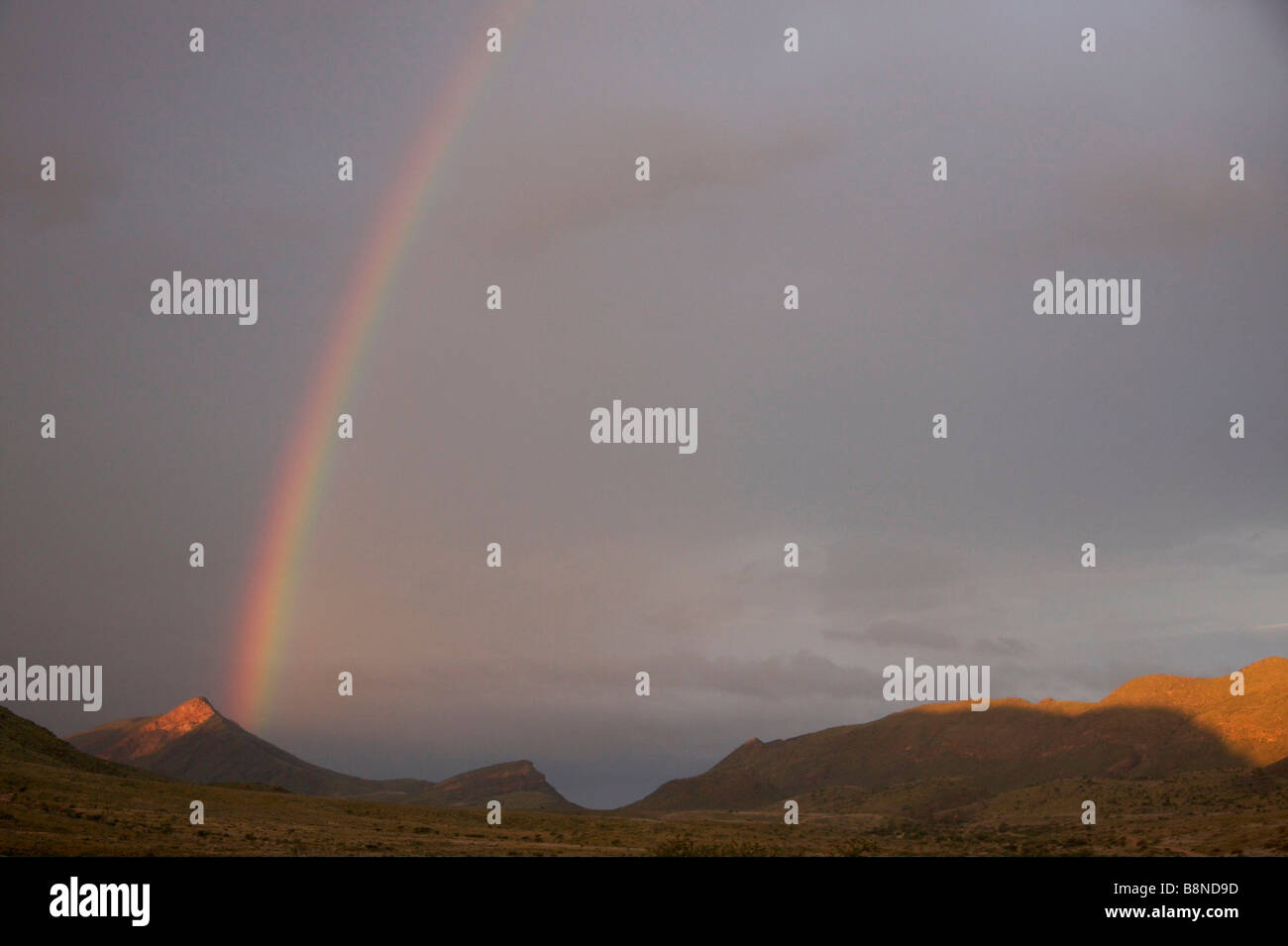 Rainbow in the Namibian countryside - Stock Image