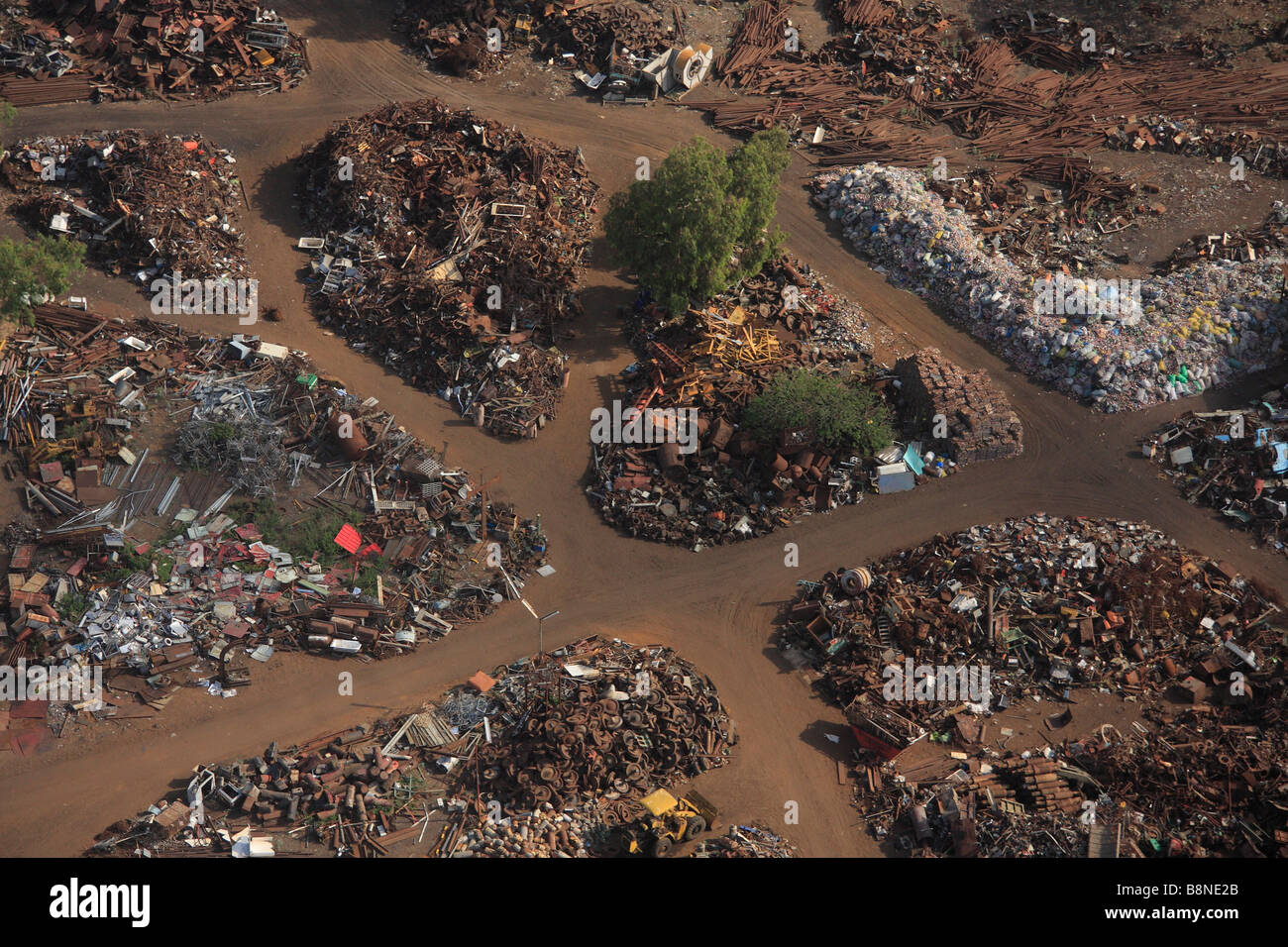 Aerial view of a junk yard with large piles of scrap metal - Stock Image