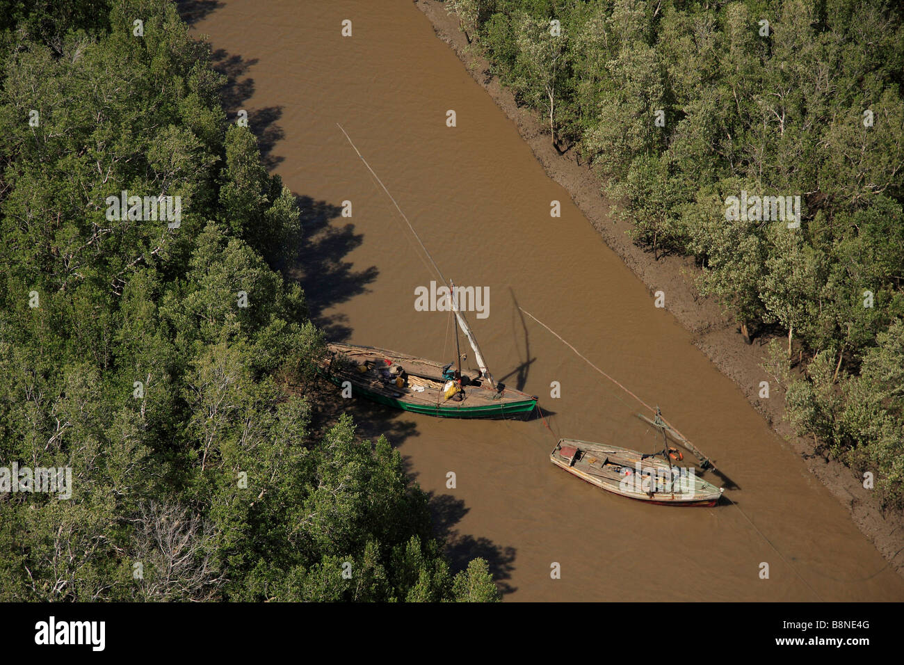 Aerial view of Dhows sheltering in a channel at low tide - Stock Image