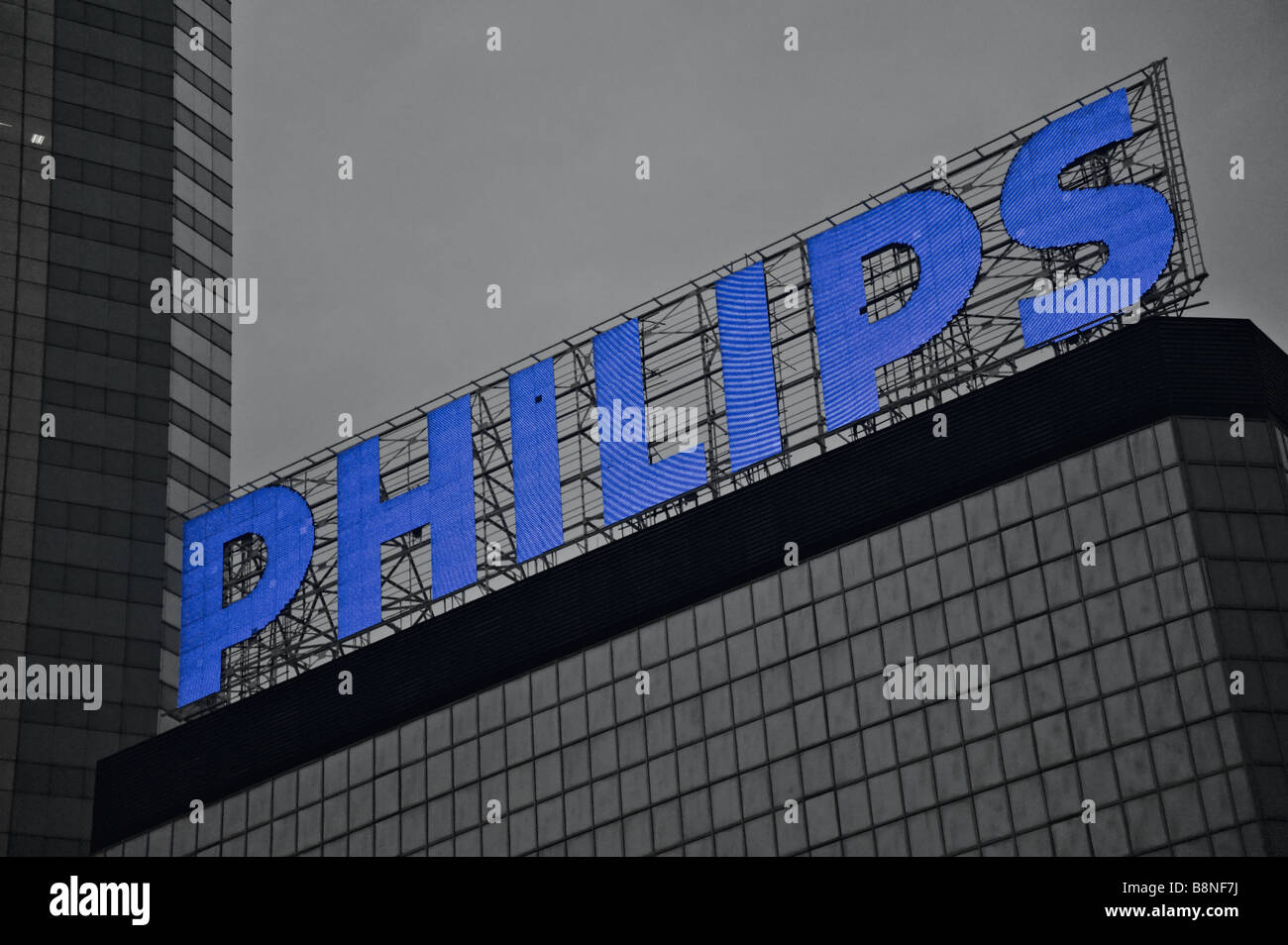 Philips corporation sign on Immigration Tower Hong Kong at the time of its installation it was the largest LED sign - Stock Image