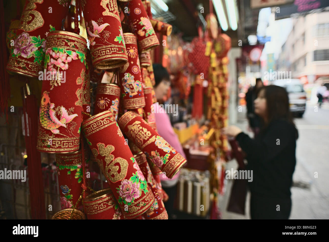 Chinese New Year decorations for sale outside stationery store Stock ...