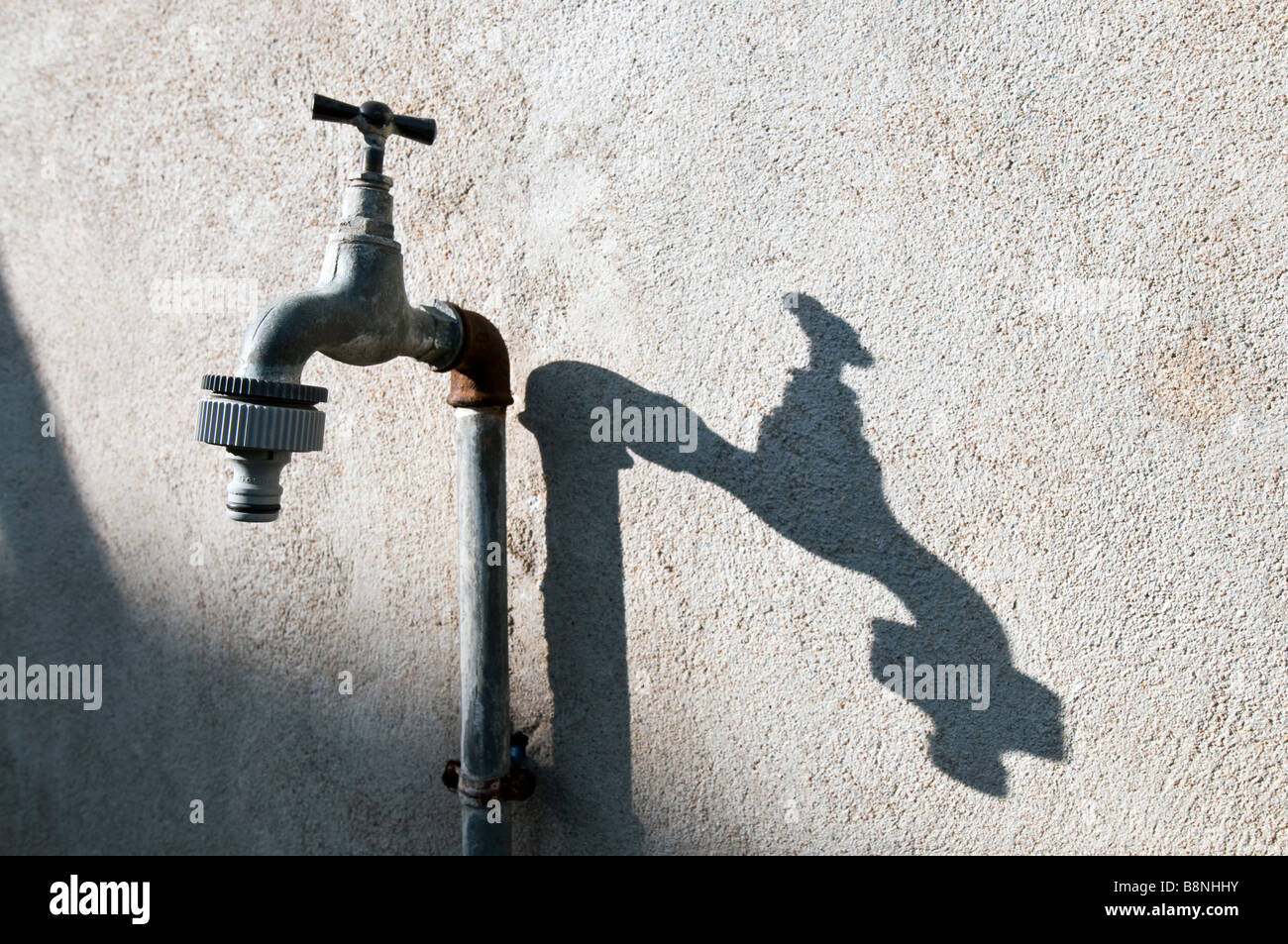 Good Outside Water Tap And Shadow On Wall, France.   Stock Image