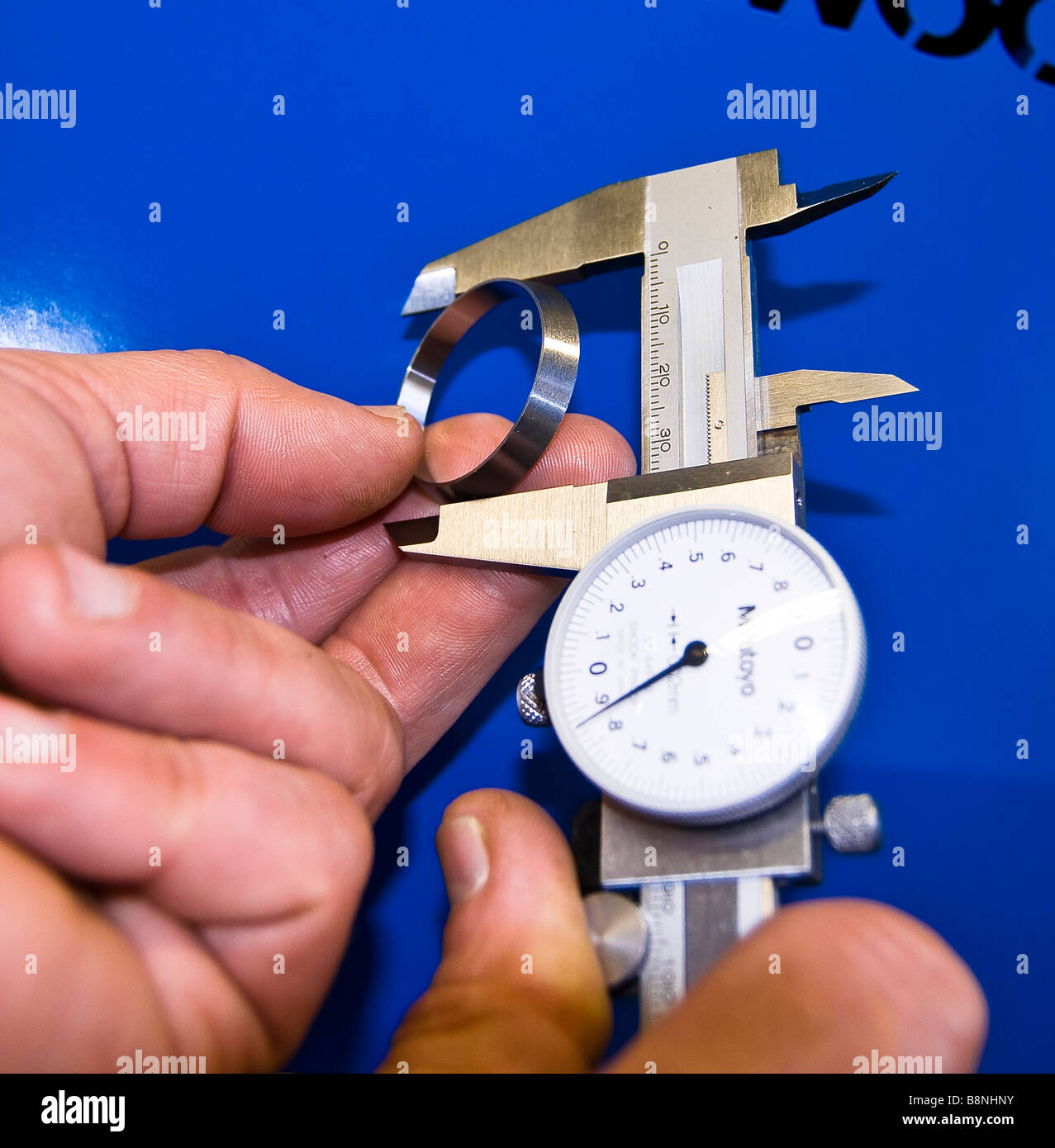 Measuring workpiece - Stock Image