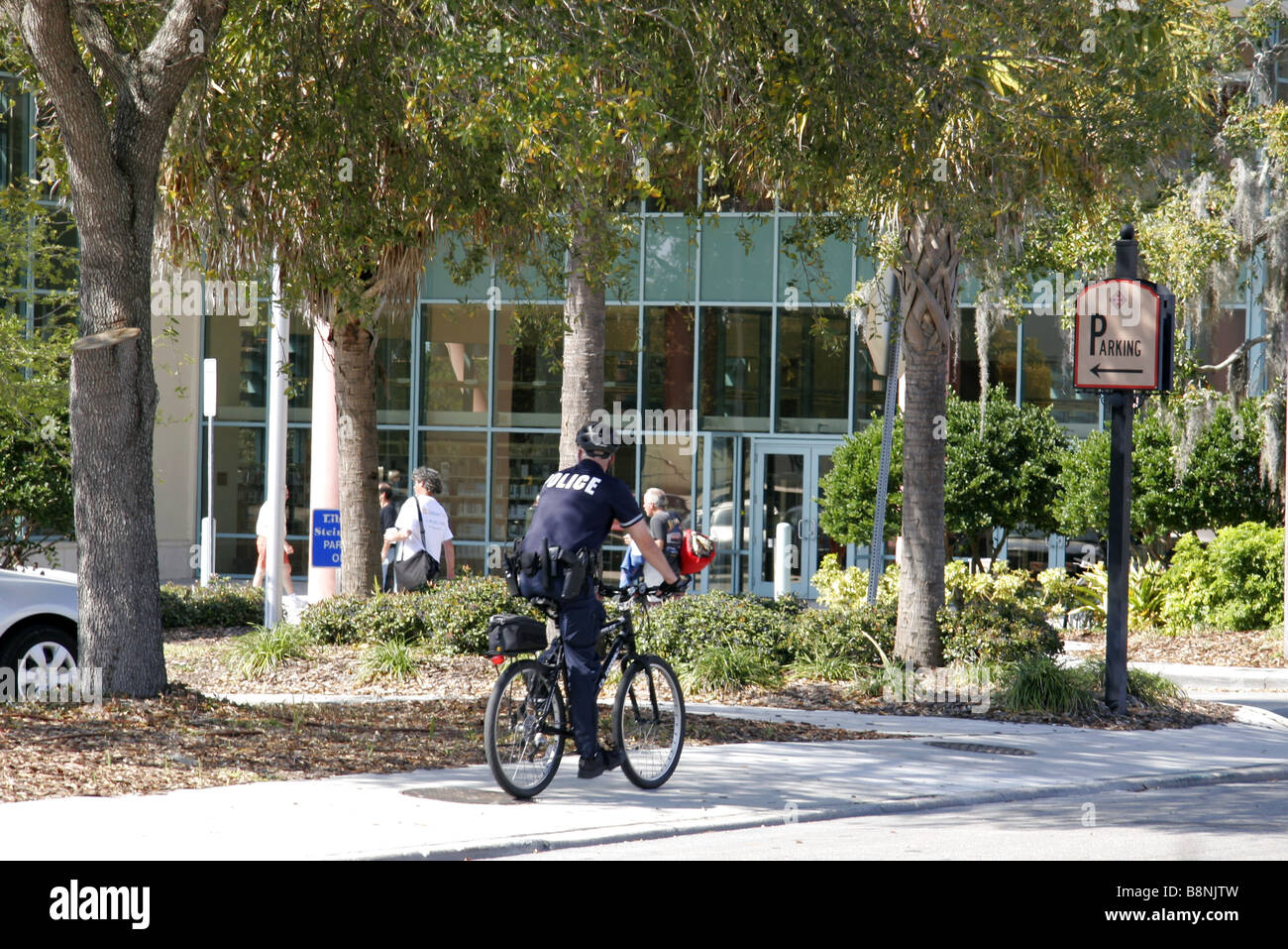 Cop on bicycle in Clearwater Florida USA - Stock Image