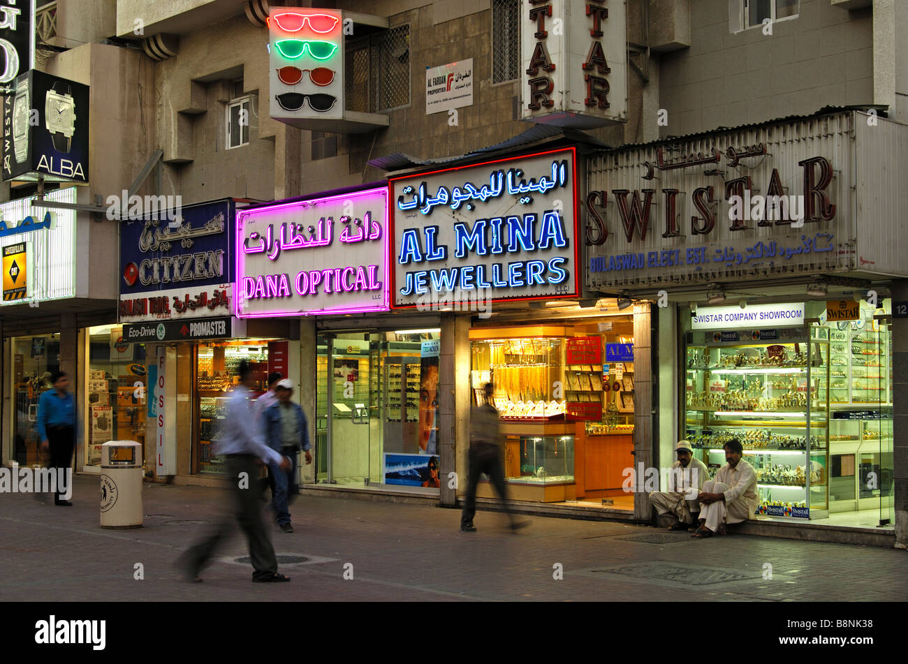 Evening time in a shopping street in the Old Town of Bur Dubai, Dubai, United Arab Emirates - Stock Image