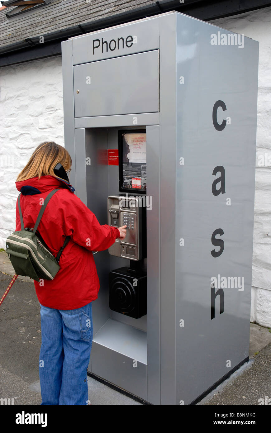 Combined Cash and pay phone machine - Stock Image