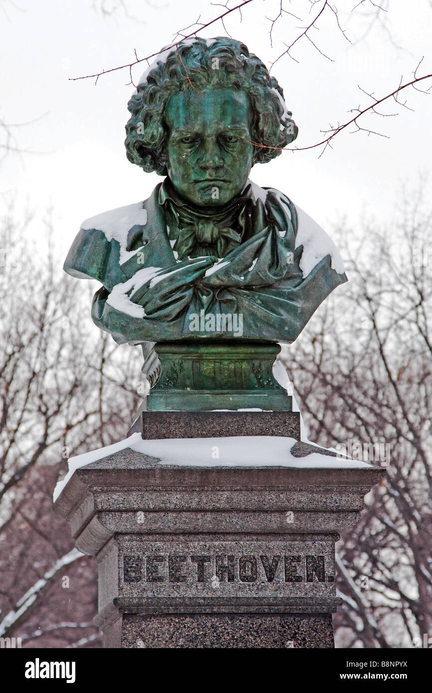 Snow covered green copper statue of Ludwig van Beethoven in the mall in Central Park New York City - Stock Image