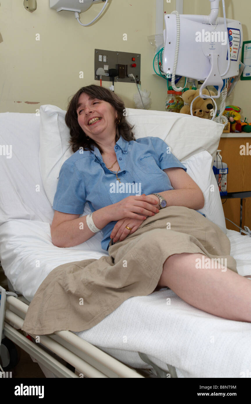 Woman Lying On Nhs Hospital Bed Of Having Had An