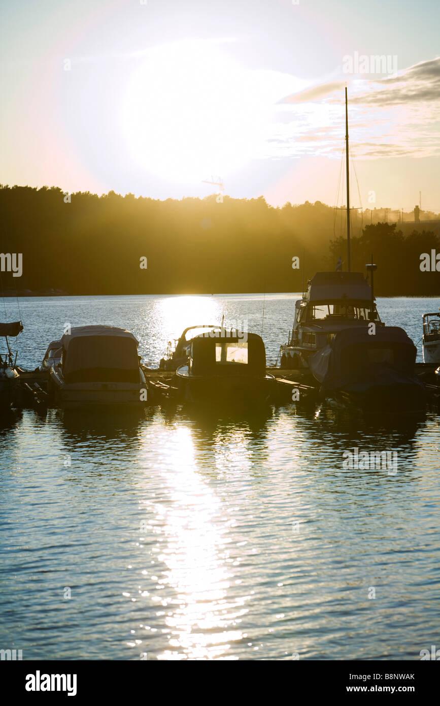 Sweden, Stockholm, Lake Malaren, sun setting over marina - Stock Image