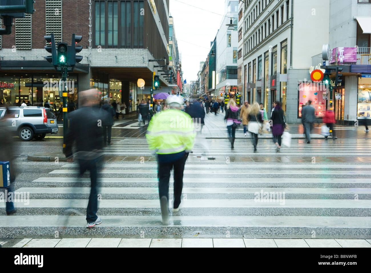 Sweden, Stockholm, pedestrians crossing street - Stock Image