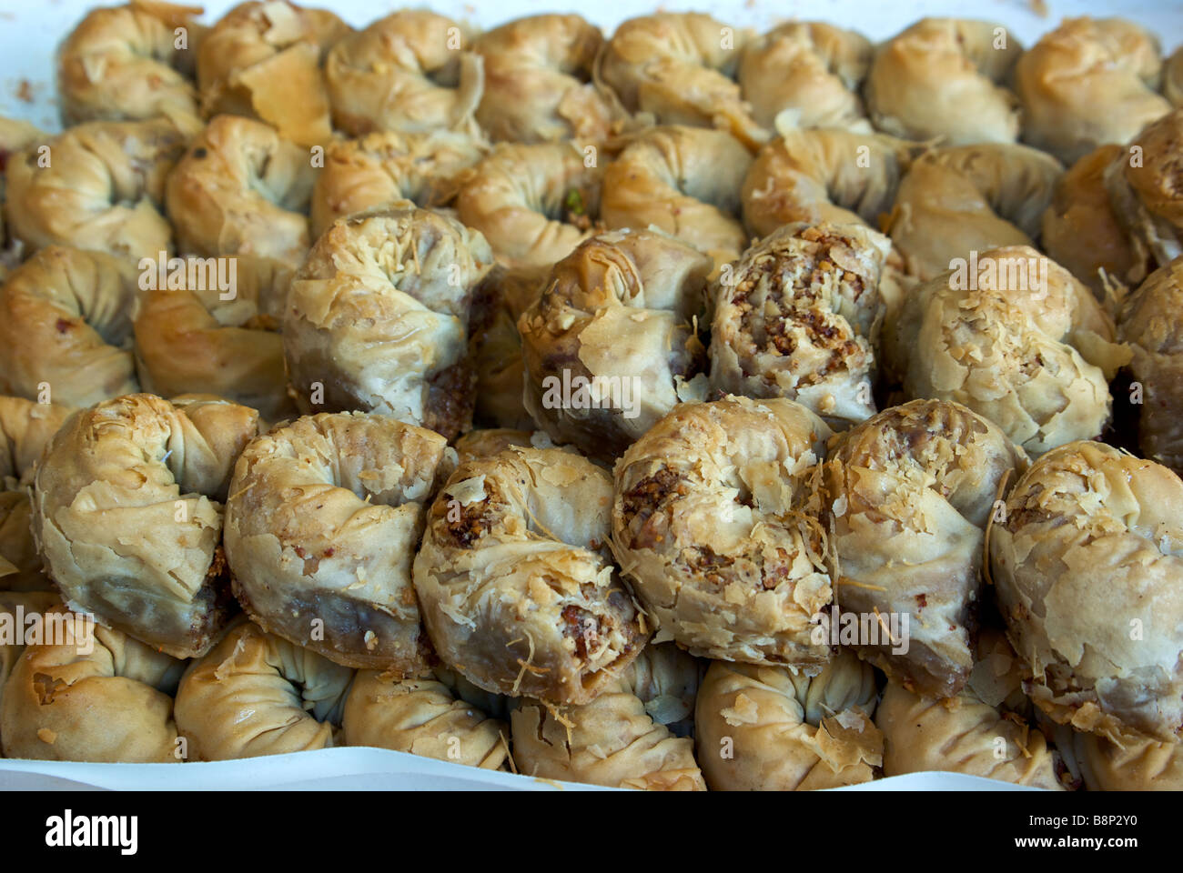 Flaky baked phyllo wrapped pastry crescent desserts at Shuk Ha Carmel open air market Stock Photo