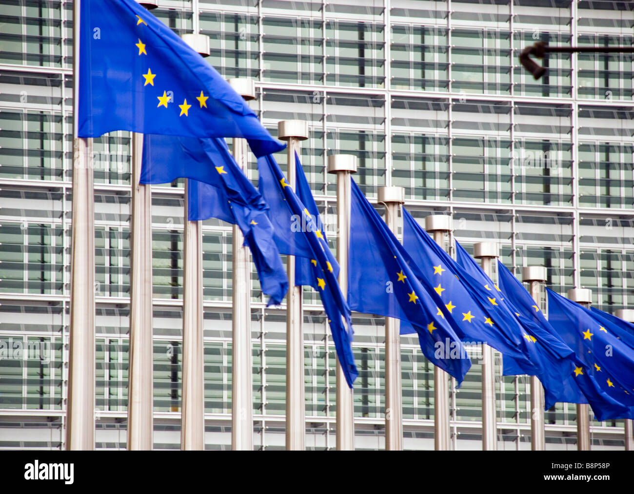 Berlaymont Schuman Brussels Belgium Flags of the European Union outside the office of the European Commission - Stock Image